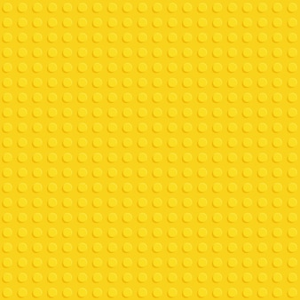 Yellow plastic construction block plate seamless pattern