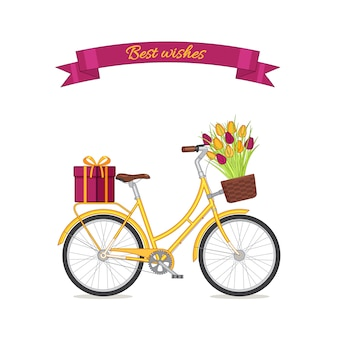Yellow retro bicycle with tulip bouquet in floral basket and giftbox on trunk.