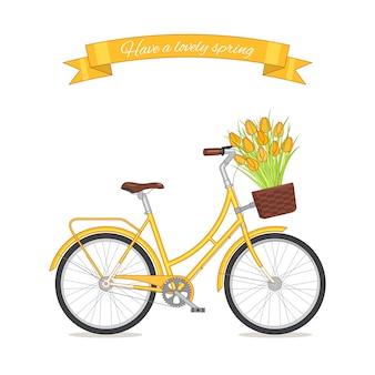 花のバスケットのチューリップの花束と黄色のレトロな自転車。カラーバイクの白い背景で隔離