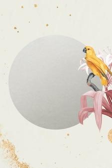黄色のセネガルオウムと丸いフレームの白いユリ