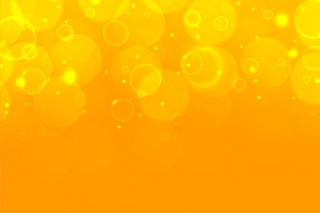 Yellow shimmering bokeh sparkles beautiful background design