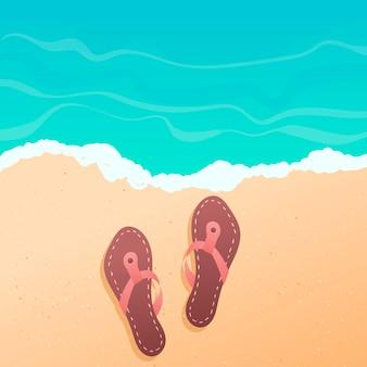 플립 플롭으로 해변에 노란색 부드러운 모래