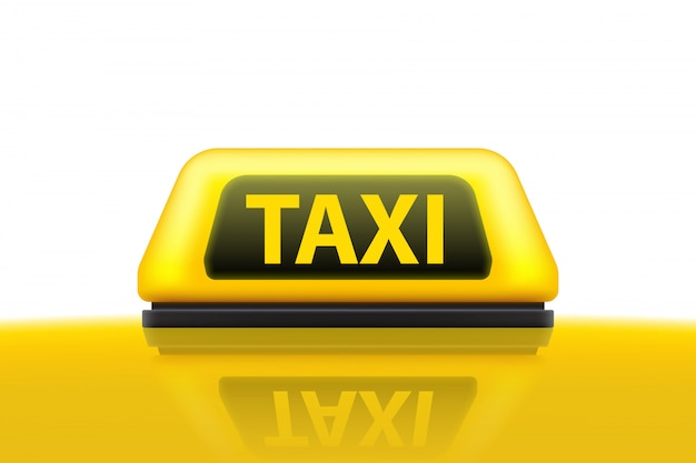 Yellow taxi service car roof sign on the street.