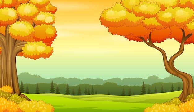 秋の風景の背景に黄色の木