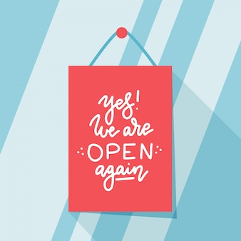 Yes, we are open again, design of small business owner welcoming customers
