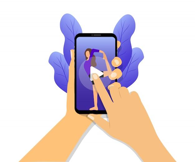 스마트 폰에서 요가 온라인 비디오. 손에 전화를 들고입니다. 온라인 요가 수업.