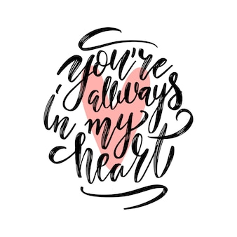 You are always in my heart. handwritting inscription of ink on a white background with pink heart.