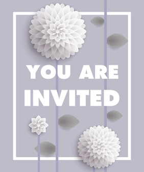 You are invited lettering with white dandelions in frame on gray background.