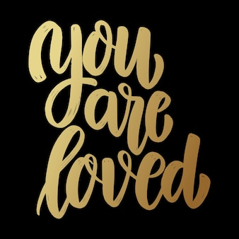 You are loved. lettering phrase on dark background. design element for poster, card, banner, sign.