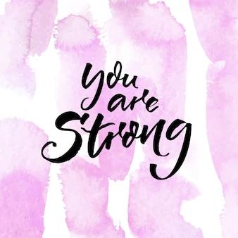 Ты сильный мотивационная цитата для постеров и социальных сетей на розовом акварельном тексте.