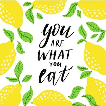 당신은 당신이 먹는 것입니다. 레몬 감귤 프레임이 있는 건강 식품 인용문. 벡터 일러스트 레이 션 흰색 배경에 고립입니다. vectorhand는 카드, 장식, 지문, 포스터를 위한 타이포그래피 디자인을 그렸습니다.