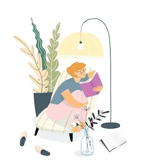ソファで本を読んでいる若い大人の女性またはティーンエイジャーの女の子。家のインテリアデザイン、本のコンセプトを読んで家で勉強してリラックス