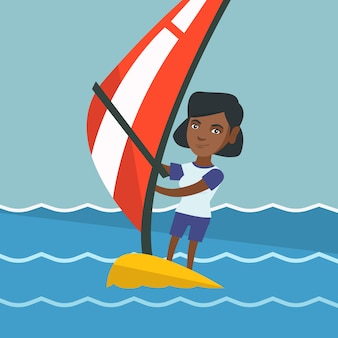 Young african-american woman windsurfing.