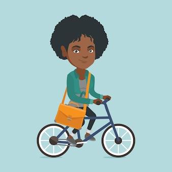 若いアフリカビジネス女性乗馬自転車。