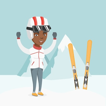Young african skier standing with raised hands.