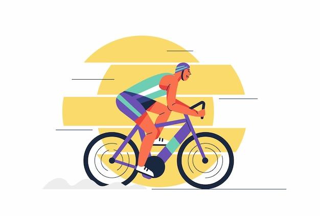 サイクリングツアー中にヘルメットとスポーツウェアの若いアスリートの男性が自転車に乗る