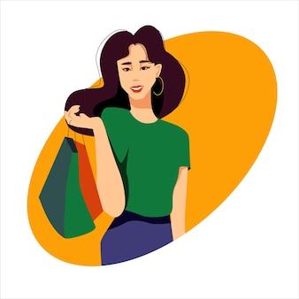 店からのバッグを持つ若い美しい現代アジアの幸せな女性シンプルな服