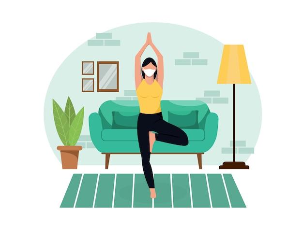 보호 마스크에 젊은 아름 다운 날씬한 여자는 격리하는 동안 거실에서 집에서 요가 않습니다. 건강 한 라이프 스타일 운동 슬리밍 휴식과 휴식.