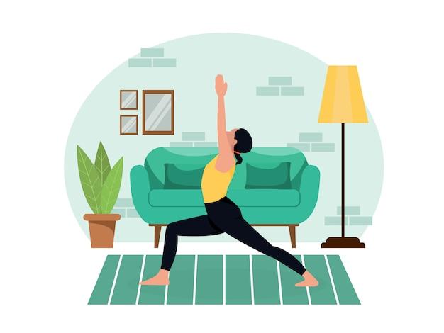 젊은 아름 다운 날씬한 여자는 격리하는 동안 거실에서 집에서 요가 관행. 건강한 라이프 스타일 운동 슬리밍 휴식과 휴식을 취하십시오.