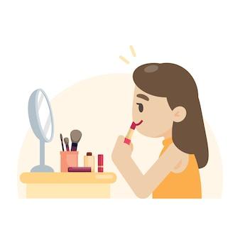 Young beautiful woman making makeup rouging her lips