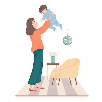 젊은 아름 다운 여자, 어머니는 거실에서 그녀의 작은 아이와 함께 연주, 제기 손에 아기를 들고