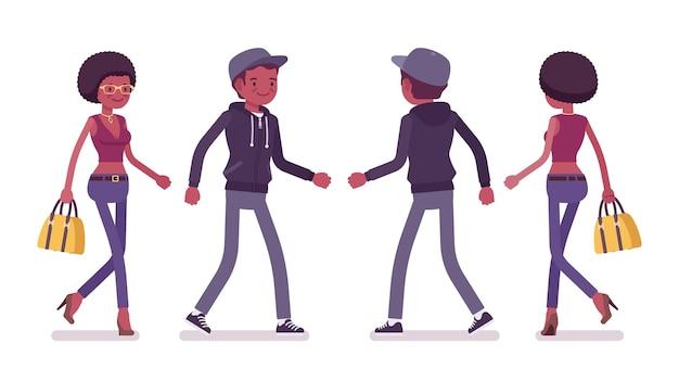 歩く若い黒人男性と女性