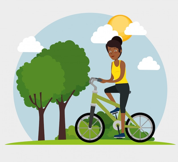 Young black woman riding bicycle