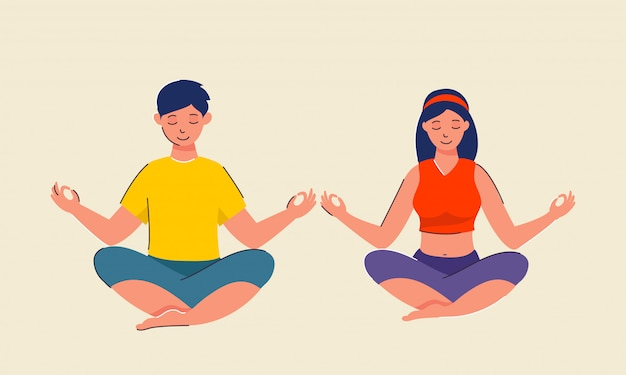 Young boy and girl meditating in lotus pose.