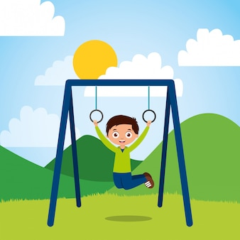 Young boy hanging rings bar in the park sunny day