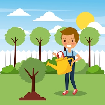 Young boy watering tree in garden with trees landscape