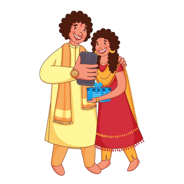 Young brother and sister selfie together from smartphone on the occasion of rakhi festival.