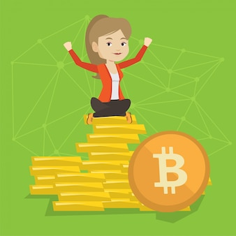 Young business woman sitting on gold bitcoin coins