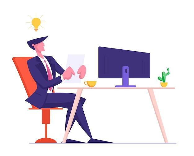 Молодой бизнесмен в официальном костюме, сидя за монитором компьютера
