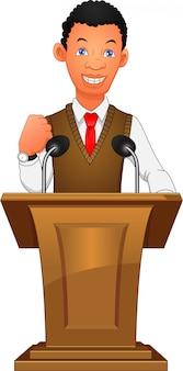 Молодой бизнесмен выступает на трибуне