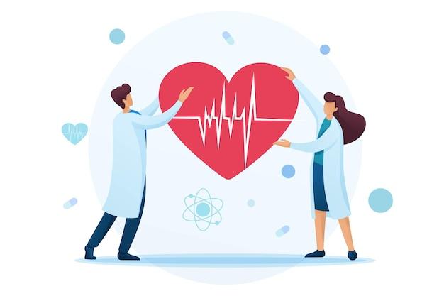 젊은 심장 전문의는 ecg를 손에 들고 심장을 쥐고 있습니다.