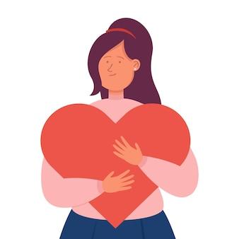 巨大な赤いハートを抱き締める若い漫画の女性