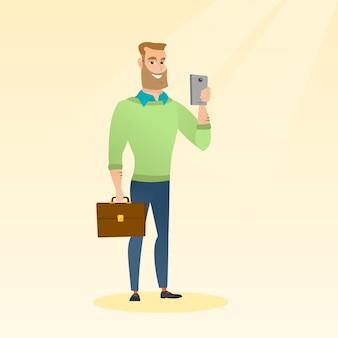 Young caucasian businessman making selfie