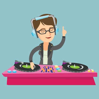 Young caucasian dj mixing music on turntables.