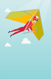 Young caucasian man flying on hang-glider