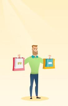Young caucasian man holding shopping bags.