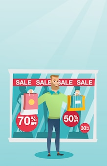 Young caucasian man shopping on sale.