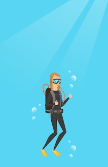 Young caucasian scuba diver giving thumb up