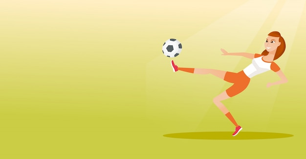Young caucasian soccer player kicking a ball