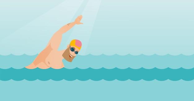 Young caucasian sportsman swimming.