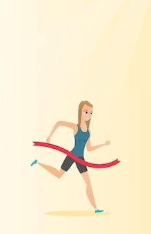 Young caucasian sportswoman crossing finish line.