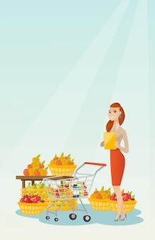Young caucasian woman checking shopping list.