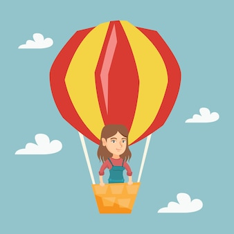 Young caucasian woman flying in hot air balloon.