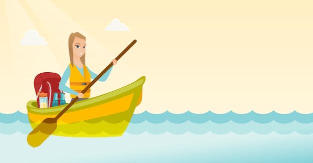 Young caucasian woman riding a kayak.