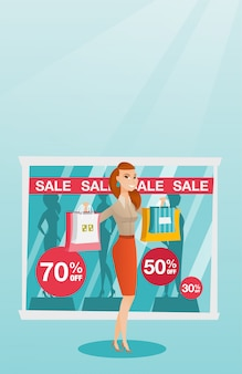 Young caucasian woman shopping on sale.