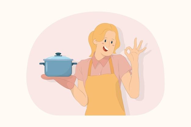 젊은 요리사 요리사 제빵사는 스테인리스 냄비를 들고 맛있는 개념을 즐기는 괜찮은 맛을 만듭니다